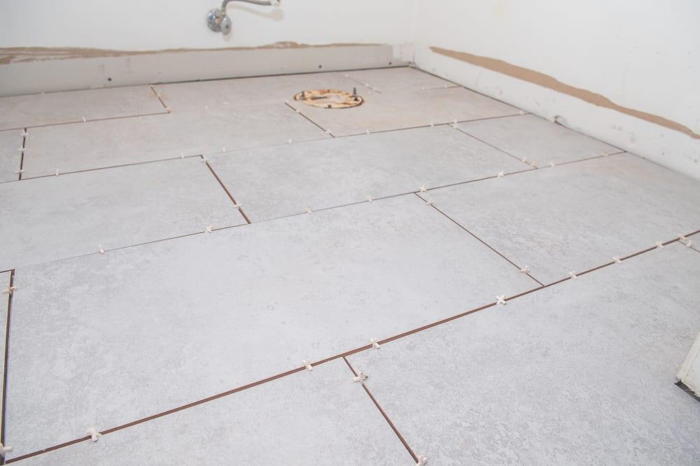 can you tile over linoleum flooring