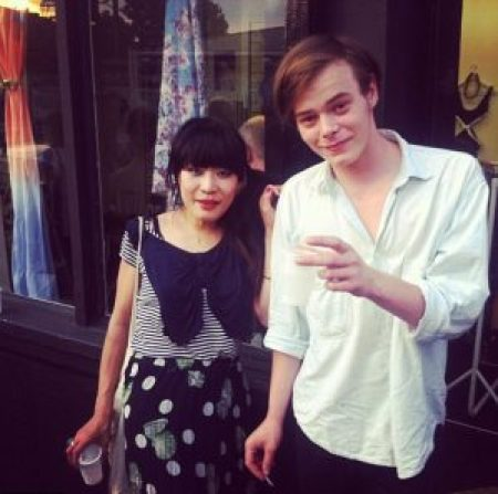 Akiko and Charlie took a picture while they were in relationship