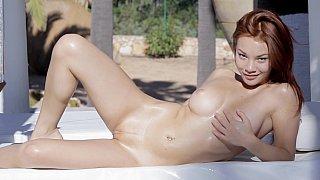 Beautiful redhead hottie doing herself image