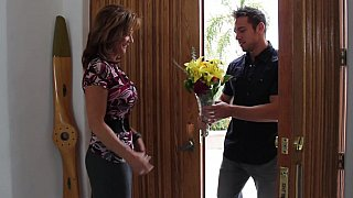 Bringing flowers to his best buddy's mom image