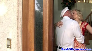Mature blonde housewife titfucks the milkman image