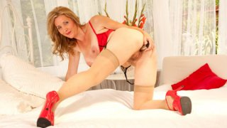Amazing milf in stockings and hairy pussy image