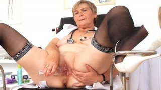 Image: Cougar masturbation with a medical-instrument in uniforms
