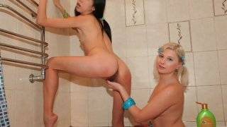 Asian and blonde lesbians fuck in shower image
