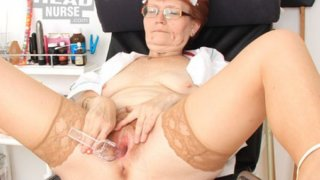 Head nurse practitioner in glasses teases her muff image
