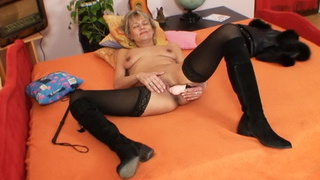 Good-looking domina wife performs strange masturbation image
