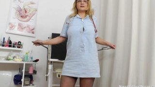 Image: Blonde ripe nurse using the medical-instrument