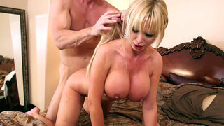 Busty cougar Nikki Benz getting pounded doggy style image