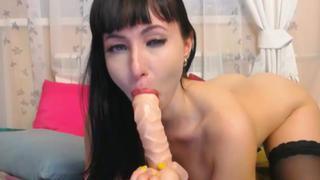 Hot Russian chick deepthroats a dildo image