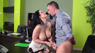 Jayden Jaymes jerks and sucks her boss' big meaty shaft image