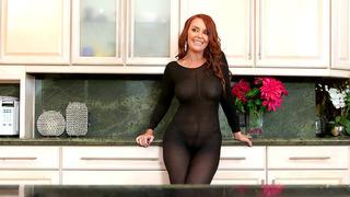 Janet Mason wearing body stockings teasing him in_the kitchen image