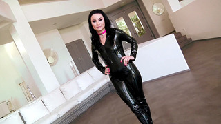 Naughty Veruca James posing in black leather bodysuit image