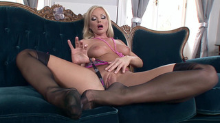 Silvia Saint in black stockings teasing and showing her pussy image