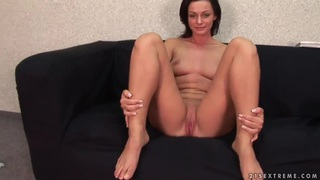 Horny brunette Cameron Cruz penetrates her pussy with a green toy image