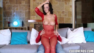 Horny Cindy Dollar in red fishnets plays with big cock image