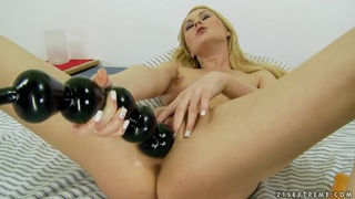 Image: Antonya playing with a huge sex toys and getting satisfied