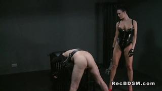 Bent over slave dude flogged domination wanking image