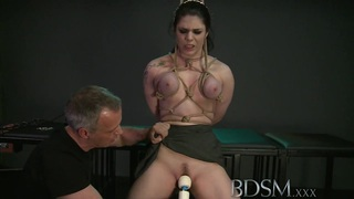 BDSM XXX Black haired sub has breasts tied by Master image