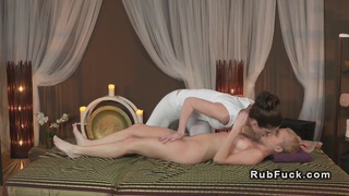 Hot lesbians oiling in massage room image