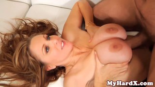 Busty milf Julia Ann titfucked before cumshot image