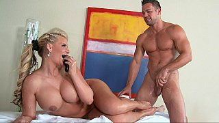 All_oiled_big_titted_Pornstar_in_action image