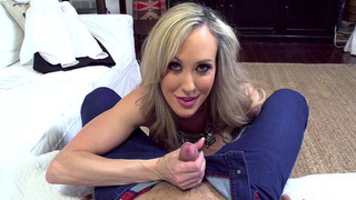 Horny MILF Brandi Love loves to suck and tug his penis image