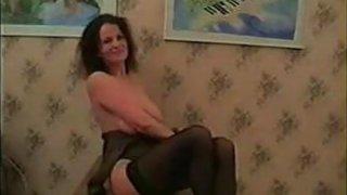 Horny Busty Mother Masturbates image