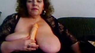 Image: Hot amateur granny fucks herself with black sex toy