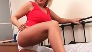 Curvy blonde plays w her huge tits image