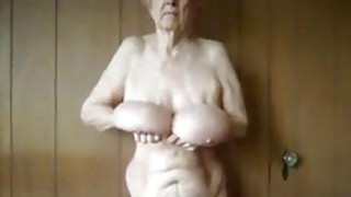 Granny Shows Off Her Saggy Breasts image