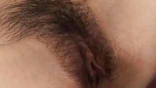 Asian lass gets her hairy pussy fingered and toyed image