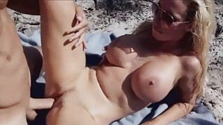 Big tittied chick in a motorboat image