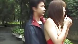 Big_boobed_Japanese_hottie_walks_in_lingerie_thru_the_park image