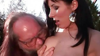 Grandpa and young brunette enjoying hot sex image