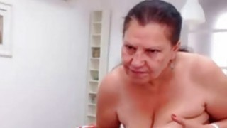 Image: OmaFotze Mature doing striptease and masturbating