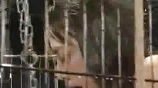 Image: Caged And Sprayed Asian Teen