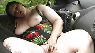 Image: BBW cleans her chubby tits at carwash