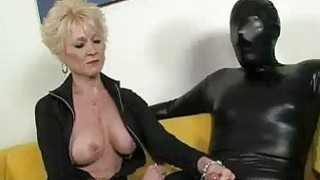 Image: Dressed In Black Big Titted Granny Examines Cock