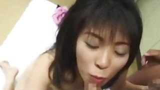 Slutty Japan babe gets showered with semen in gang bang image