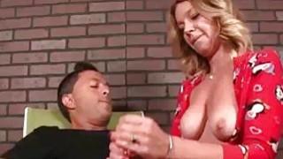 Milf Jerks His Huge Cock Till His Balls Tighten Up image