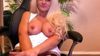 Image: Busty mature having a naughty solo masturbation with sex Toy