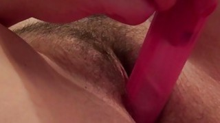 Image: Horny mature lady toying her hairy pussy
