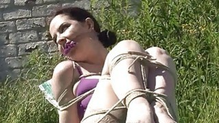 Outdoor bondage and_cloth gagging of dominated sub image