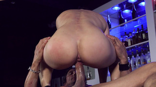 Image: Big ass bartender Lea Lexis riding big cock on the bar stand