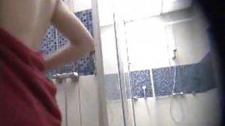 Amateur cuties spied in a public shower image
