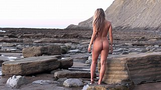 Nude babe morning walk at the ocean shore image