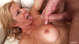 Busty MILF titfucked and creamed image
