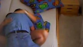Spy_video_of_my_slutty_mom_with_her_handyman image