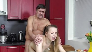 Steamy sex in the kitchen between young babe image