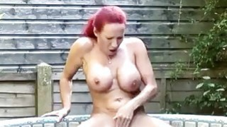 Image: Big titted redhead mature masturbating in solo